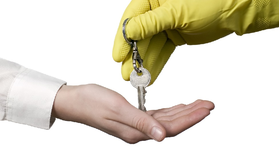 Cleaning worker is giving key for businessman